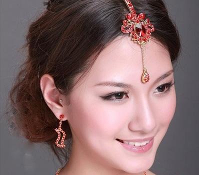 中式婚庆新娘妆造型,喜庆红色新娘发型欣赏图片